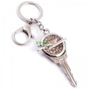 Ключодържател във формата на ключ с емблема декориран с бели камъни на Opel